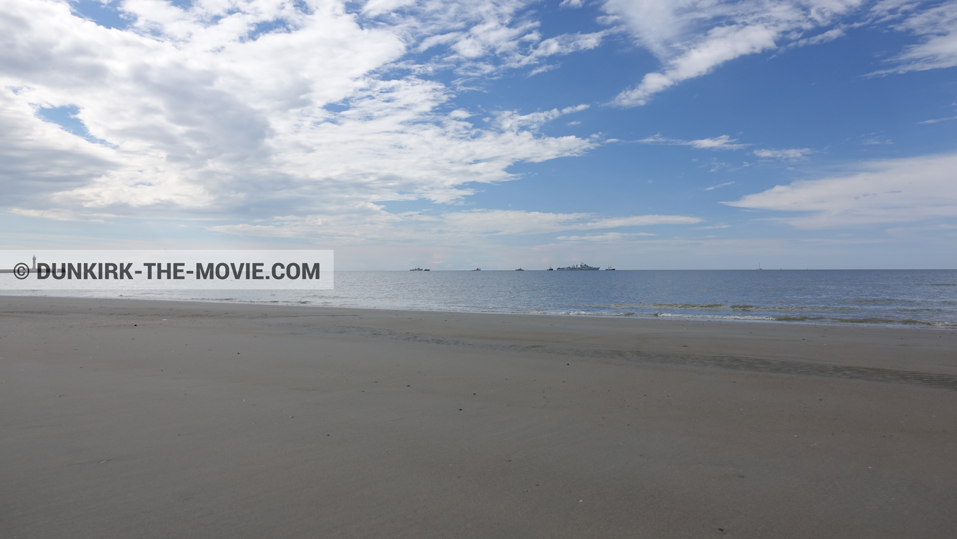 Picture with boat, cloudy sky, St Pol sur Mer lighthouse, beach,  from behind the scene of the Dunkirk movie by Nolan