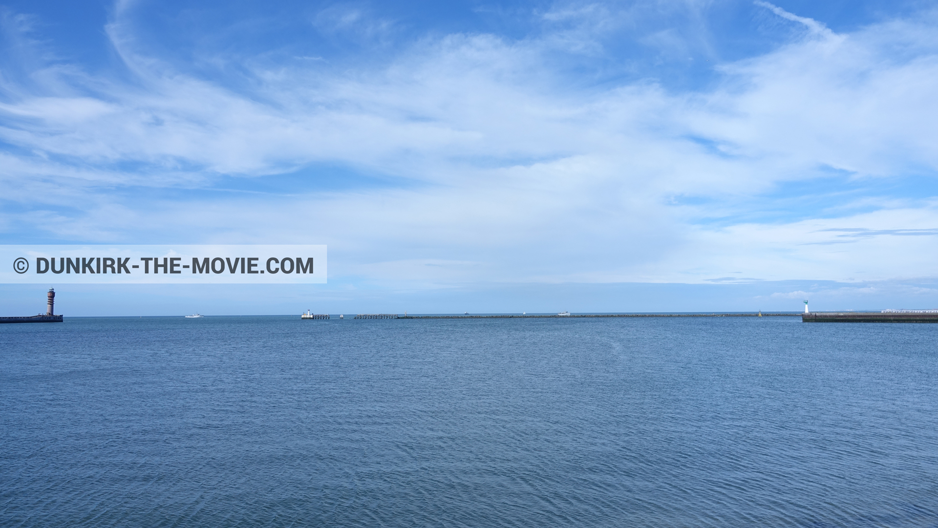 Picture with boat, cloudy sky, calm sea, St Pol sur Mer lighthouse,  from behind the scene of the Dunkirk movie by Nolan
