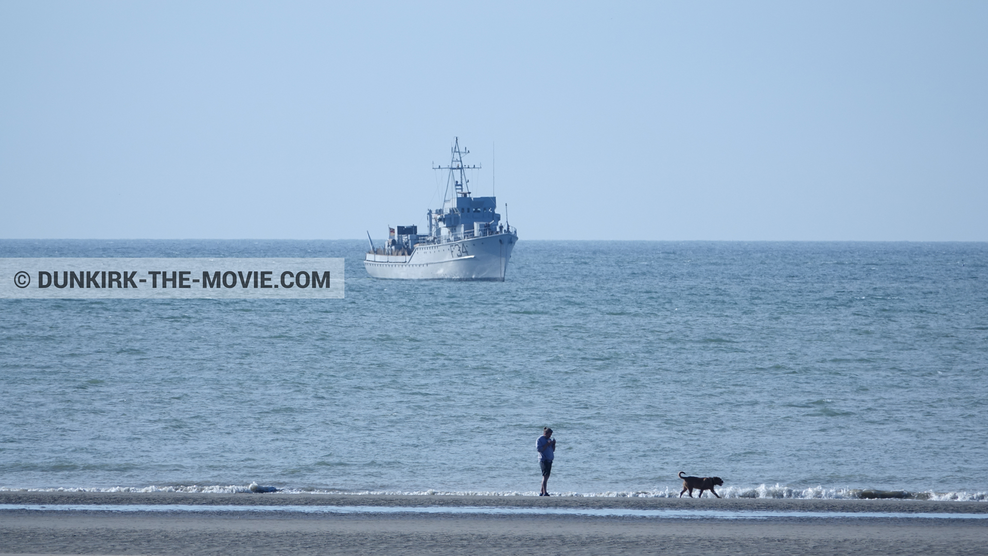 Picture with blue sky, F34 - Hr.Ms. Sittard, calm sea, beach,  from behind the scene of the Dunkirk movie by Nolan