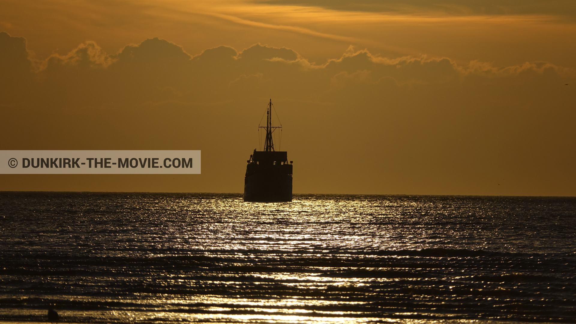 Picture with boat, orange sky,  from behind the scene of the Dunkirk movie by Nolan