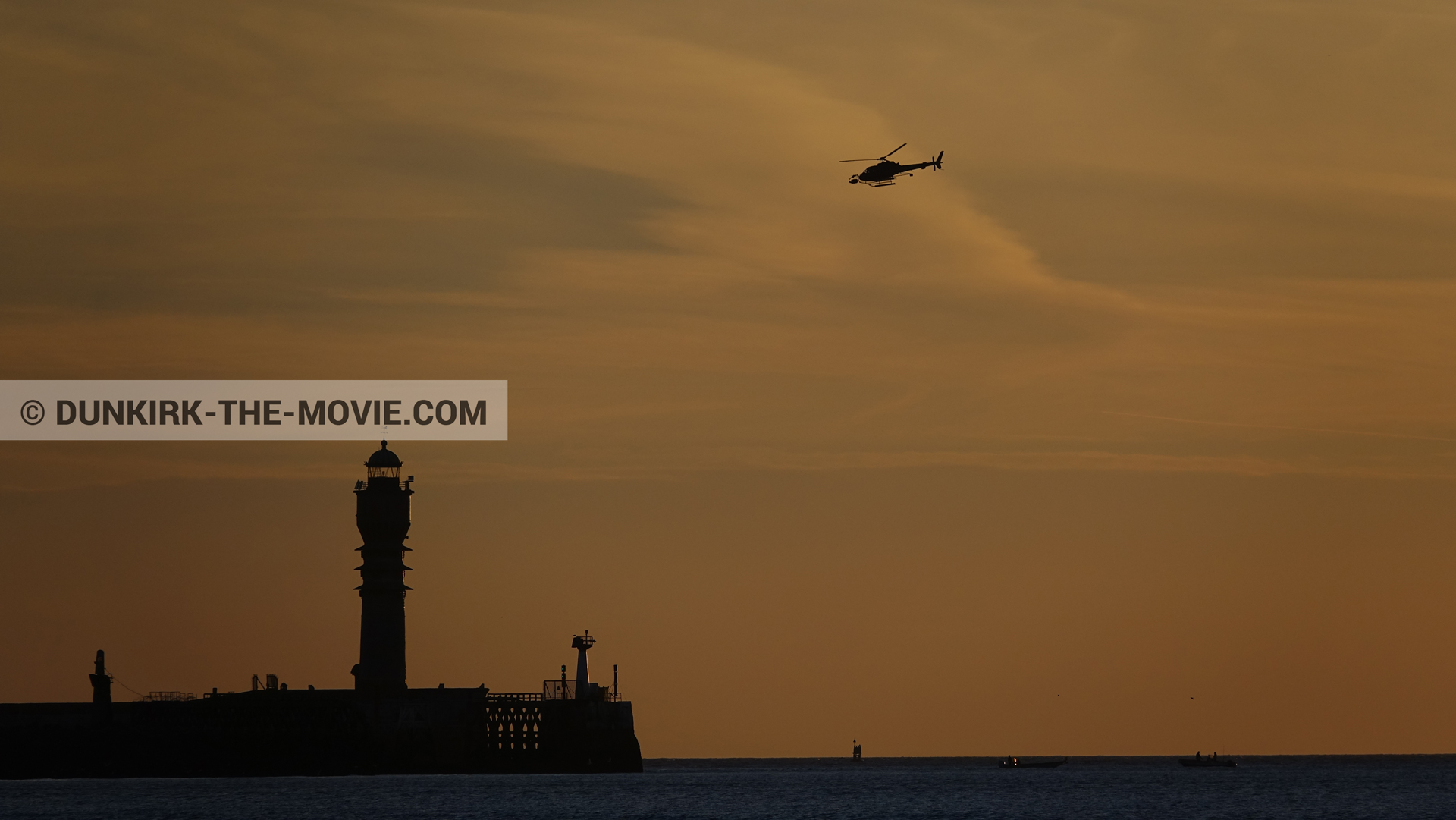 Picture with orange sky, helicopter camera, St Pol sur Mer lighthouse,  from behind the scene of the Dunkirk movie by Nolan