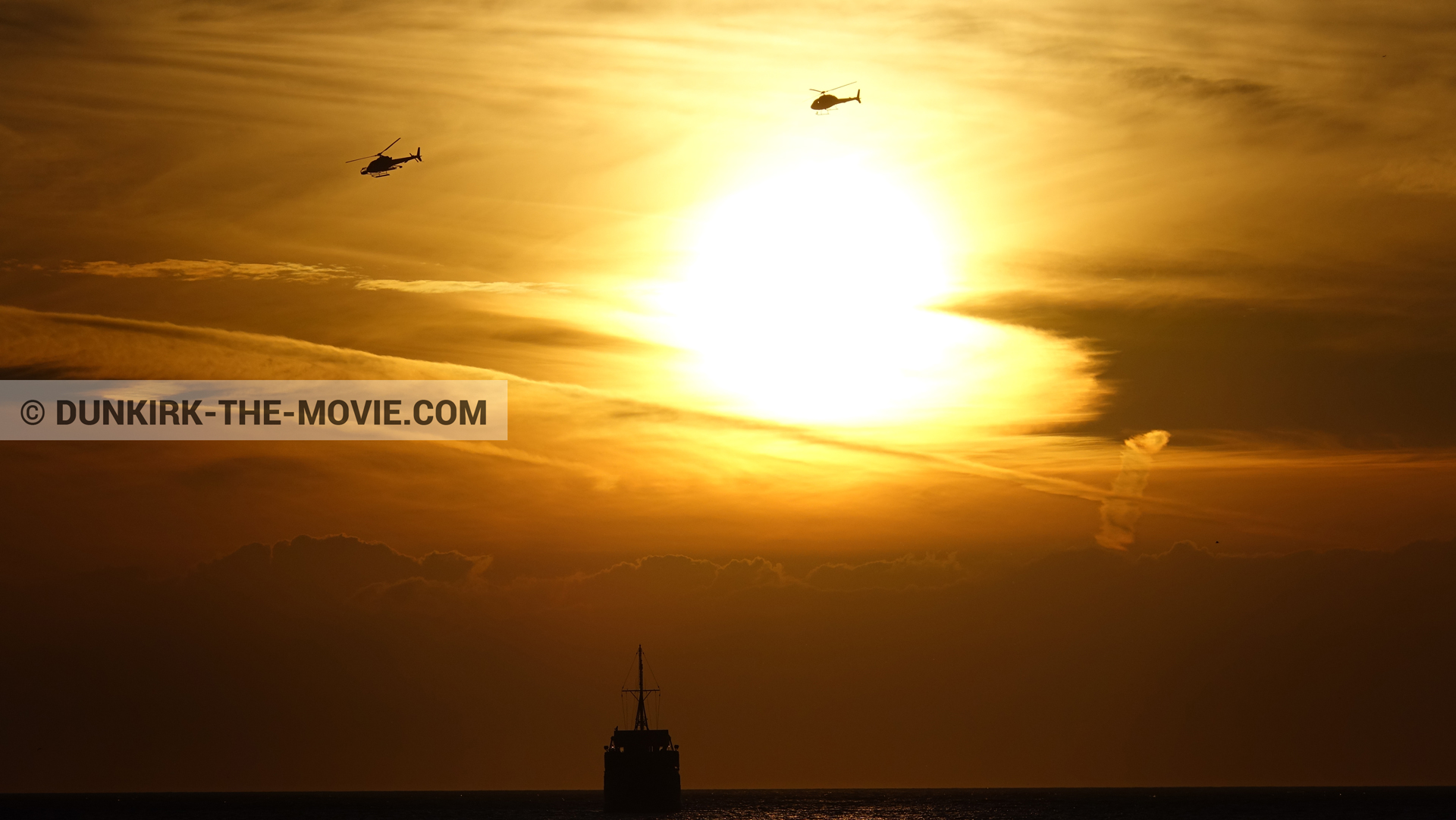 Picture with boat, orange sky, helicopter camera,  from behind the scene of the Dunkirk movie by Nolan