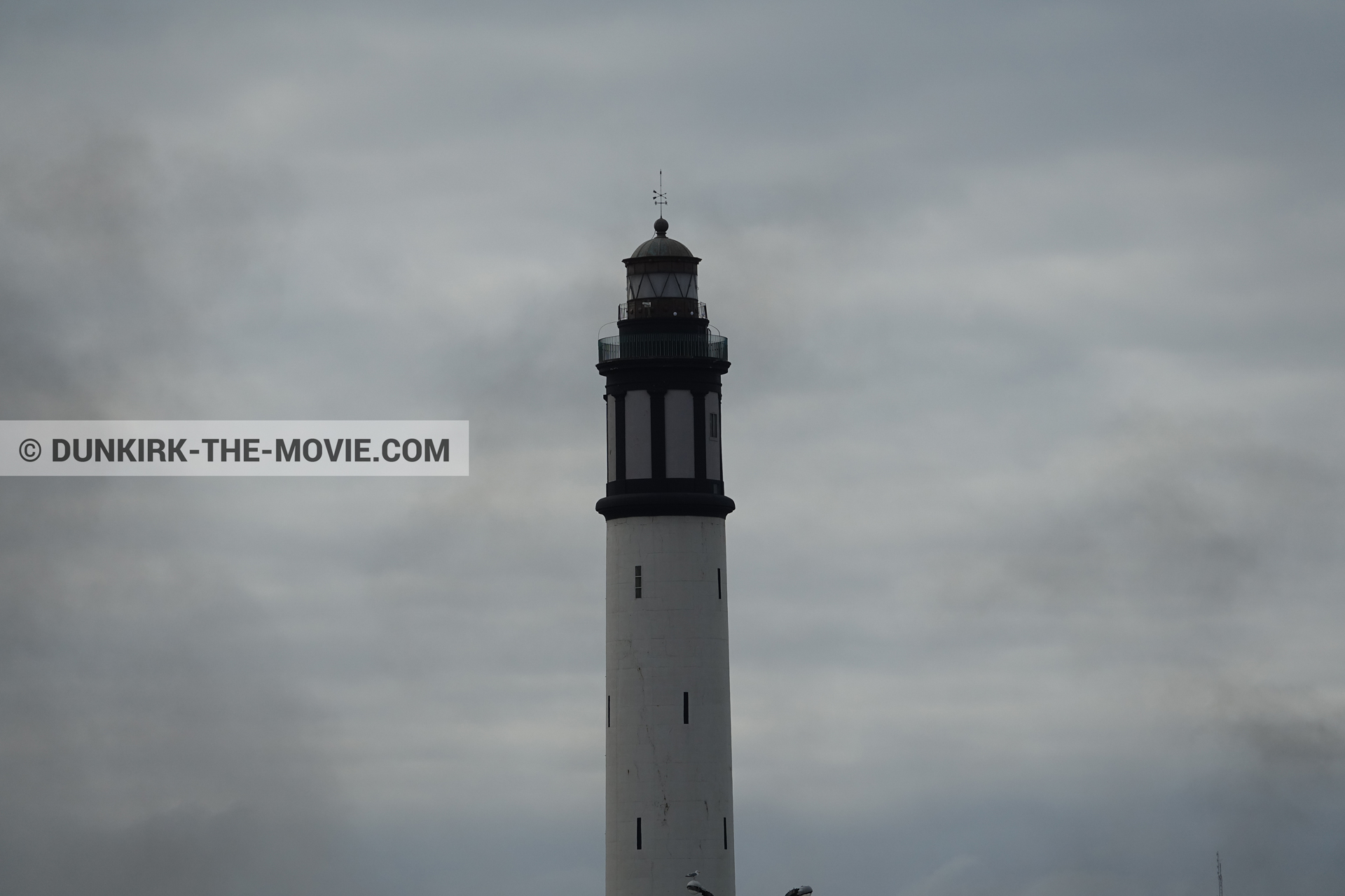 Picture with cloudy sky, Dunkirk lighthouse,  from behind the scene of the Dunkirk movie by Nolan