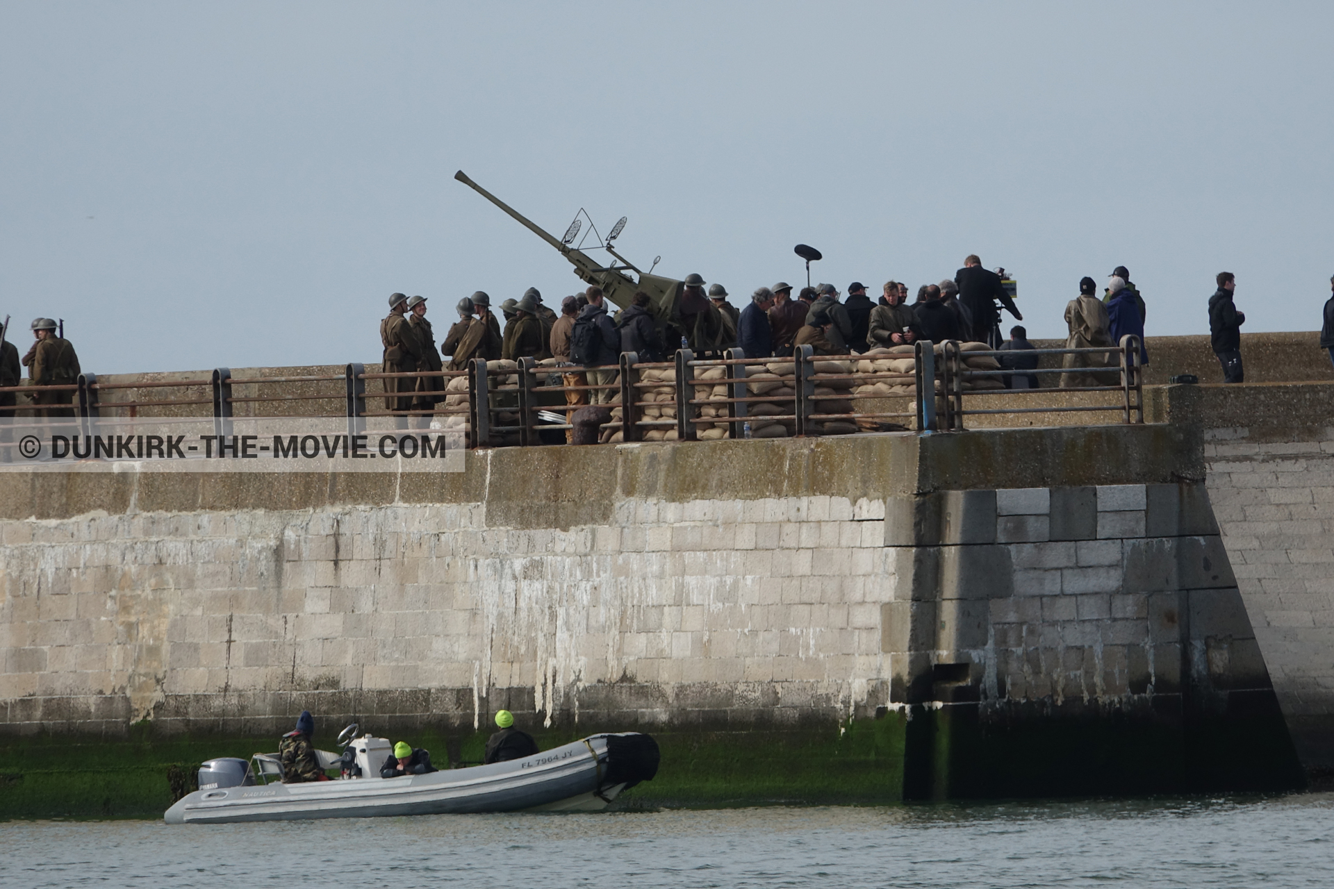 Picture with cannon, supernumeraries, EST pier, inflatable dinghy,  from behind the scene of the Dunkirk movie by Nolan
