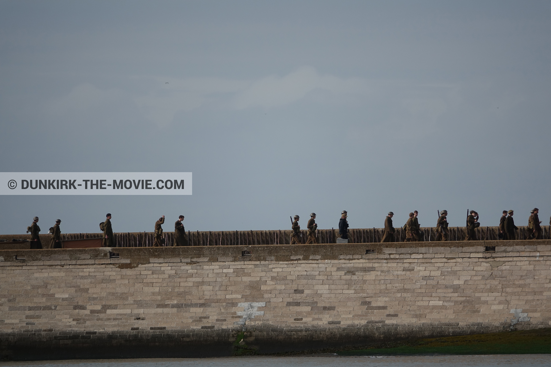 Picture with supernumeraries, EST pier, grey sky,  from behind the scene of the Dunkirk movie by Nolan