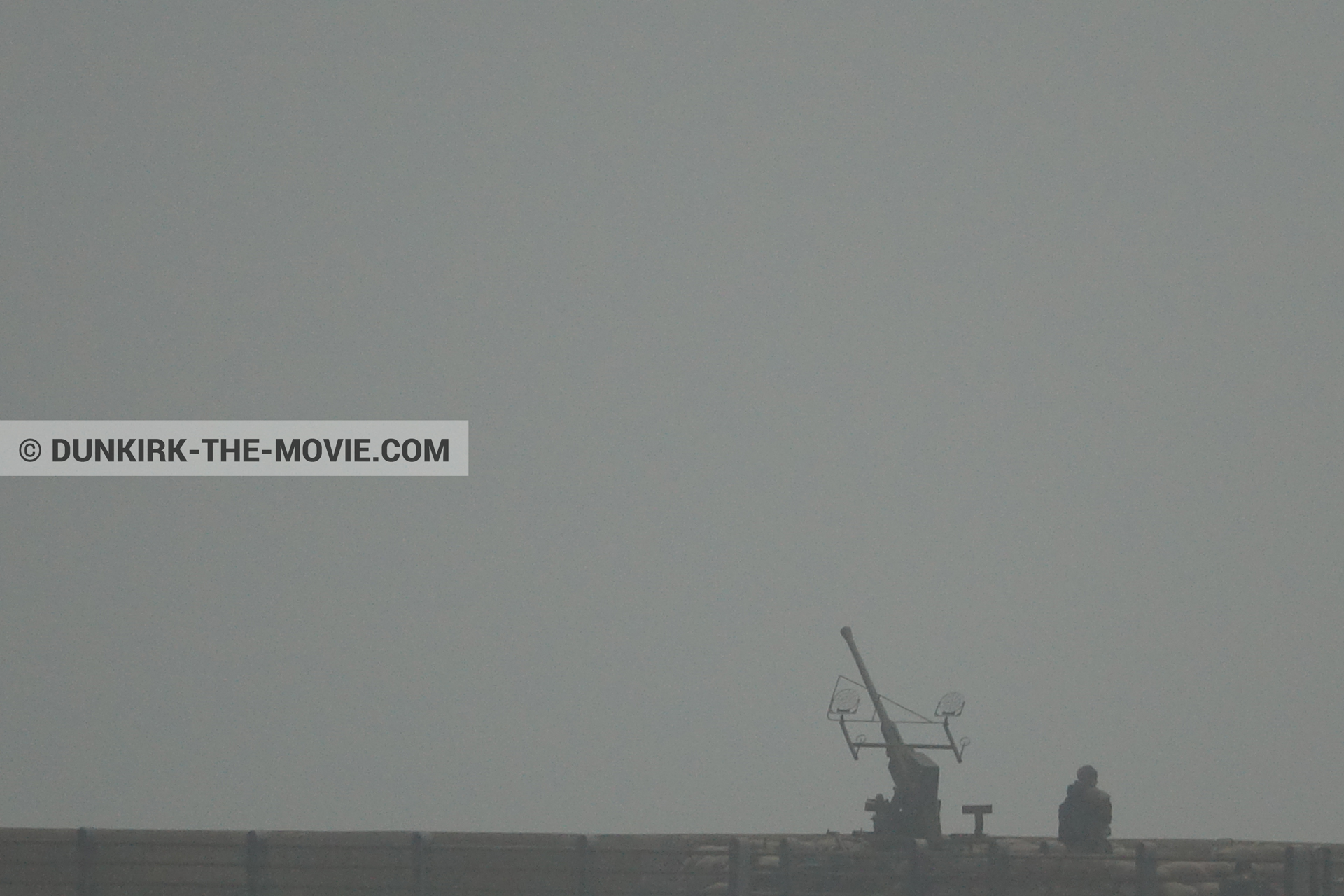 Picture with cannon, grey sky, EST pier,  from behind the scene of the Dunkirk movie by Nolan