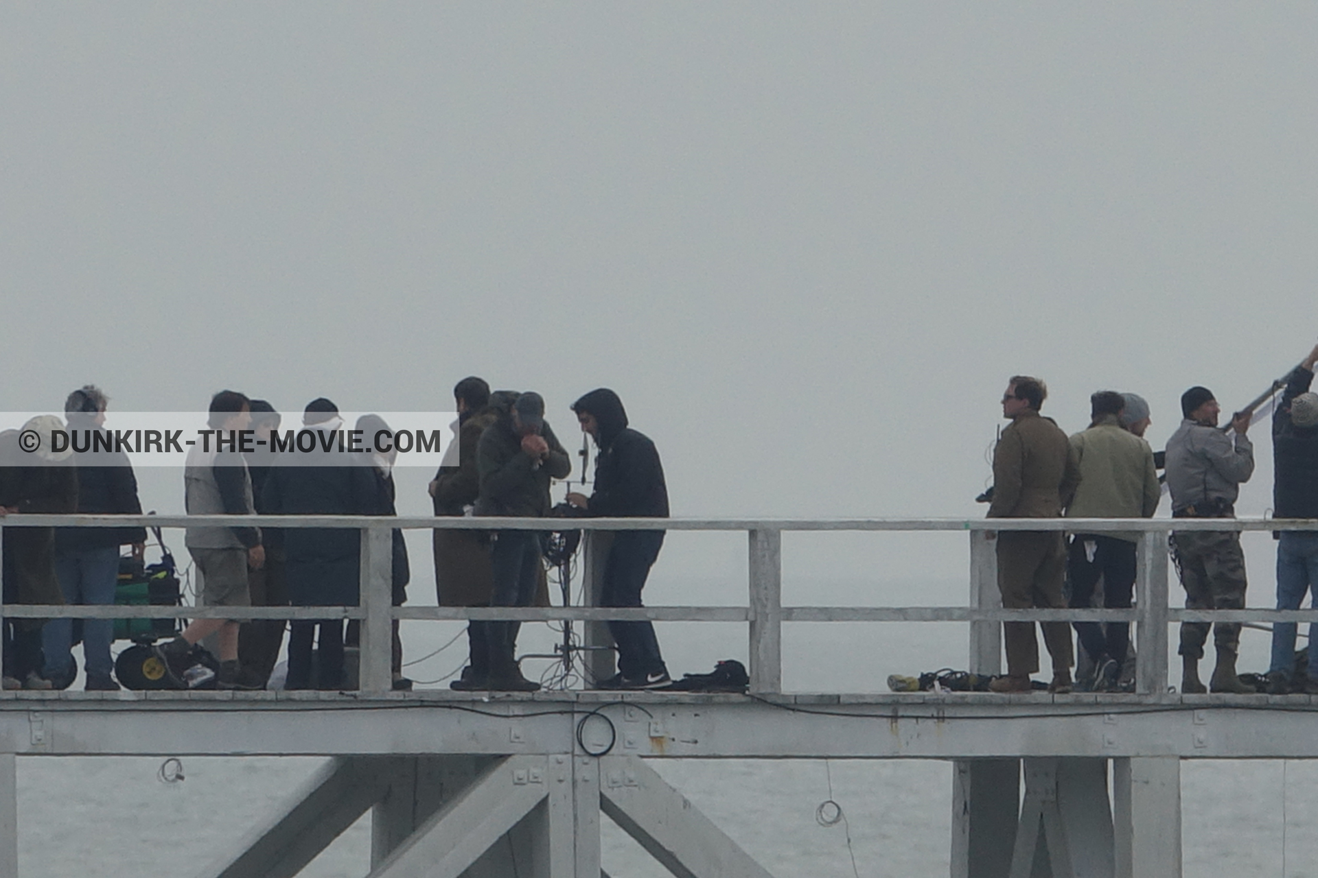 Picture with grey sky, EST pier, technical team,  from behind the scene of the Dunkirk movie by Nolan