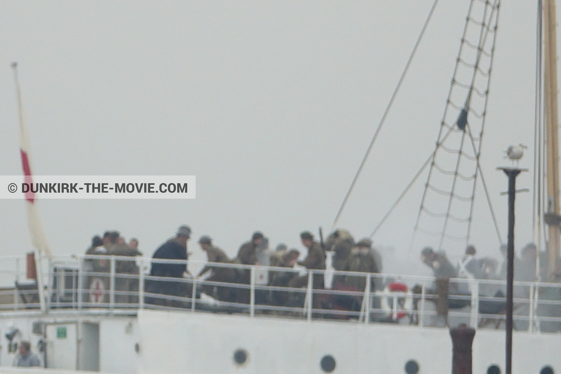 Picture with grey sky, supernumeraries, white smoke, EST pier, M/S Rogaland,  from behind the scene of the Dunkirk movie by Nolan