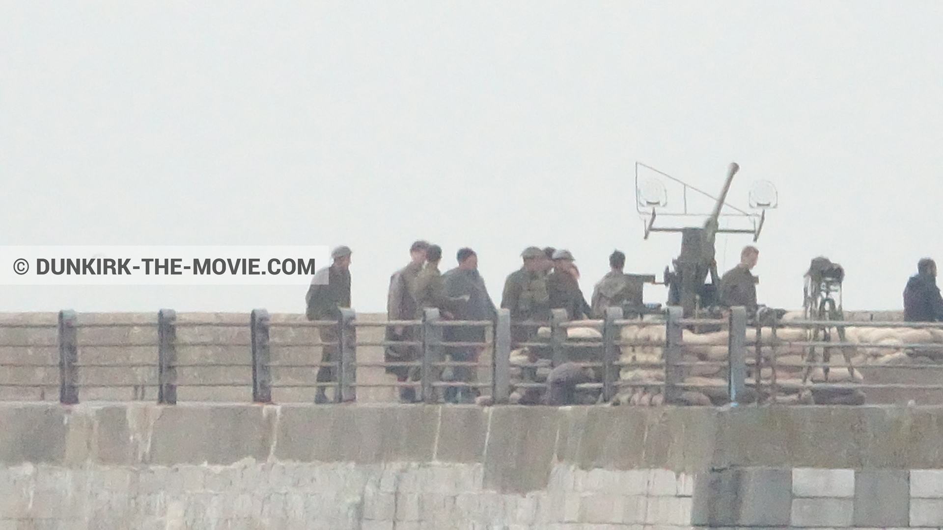 Picture with cannon, grey sky, supernumeraries, EST pier,  from behind the scene of the Dunkirk movie by Nolan