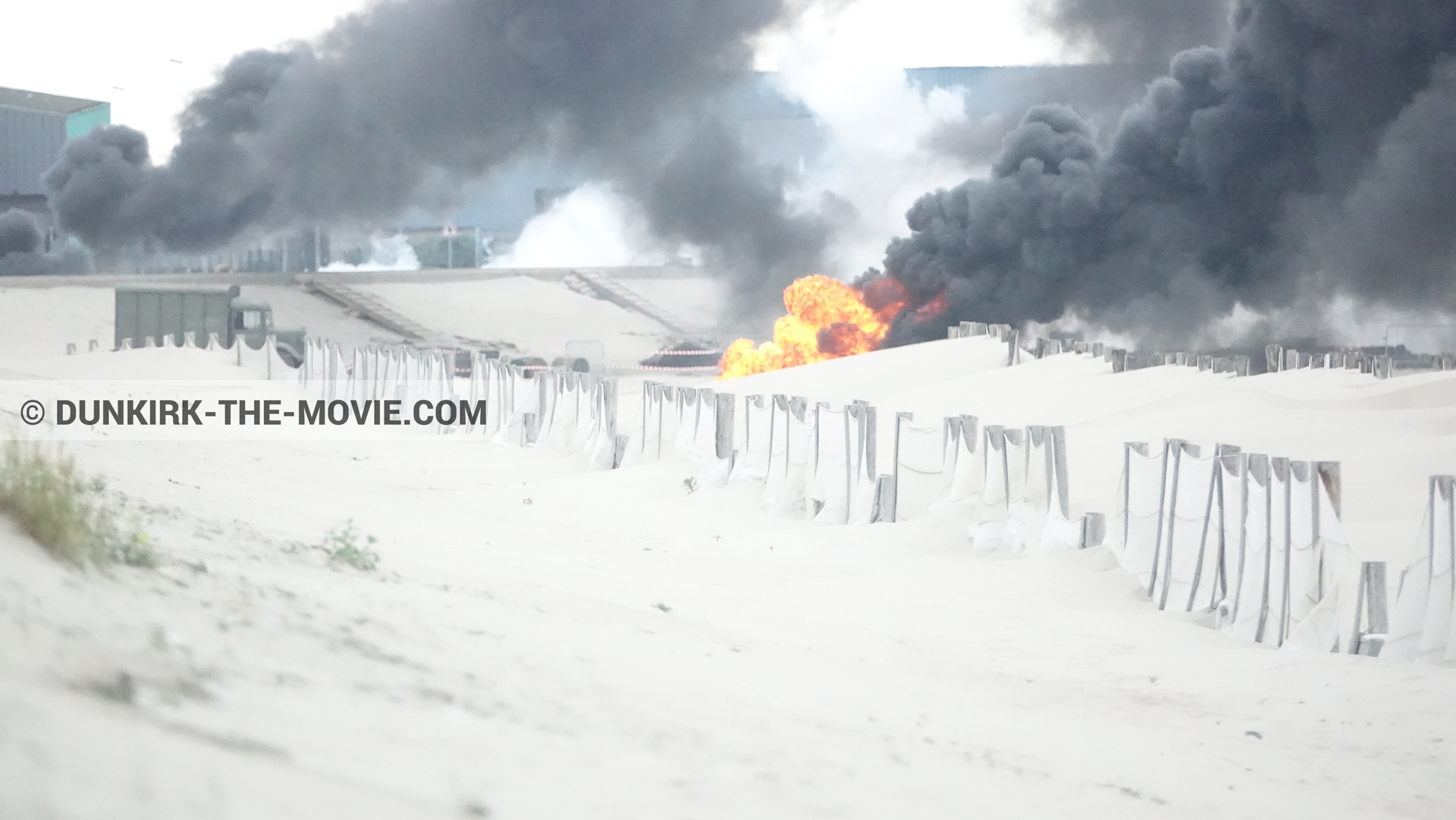 Picture with truck, black smoke, beach,  from behind the scene of the Dunkirk movie by Nolan
