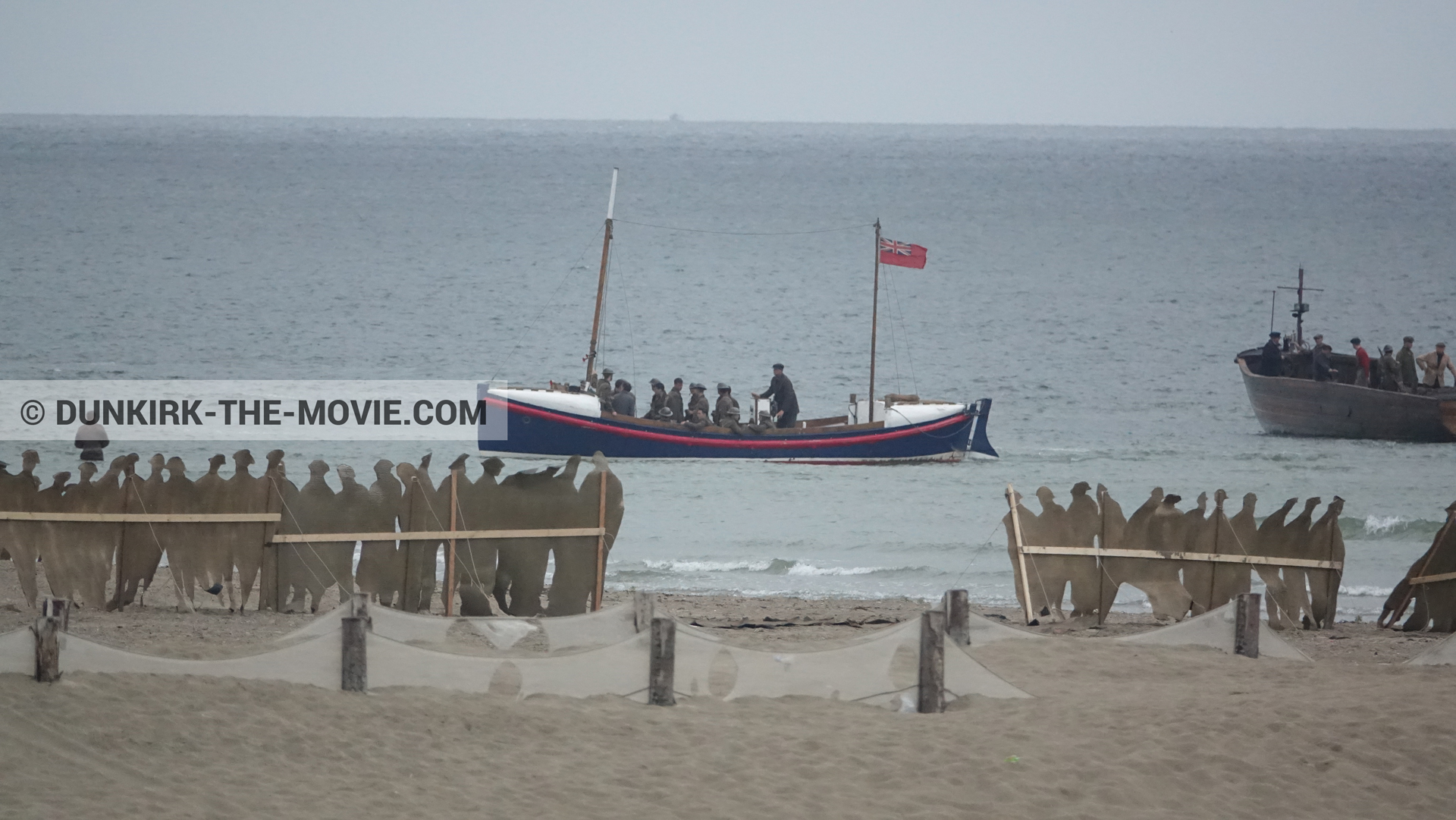 Picture with boat, decor, supernumeraries, beach, Henry Finlay lifeboat,  from behind the scene of the Dunkirk movie by Nolan